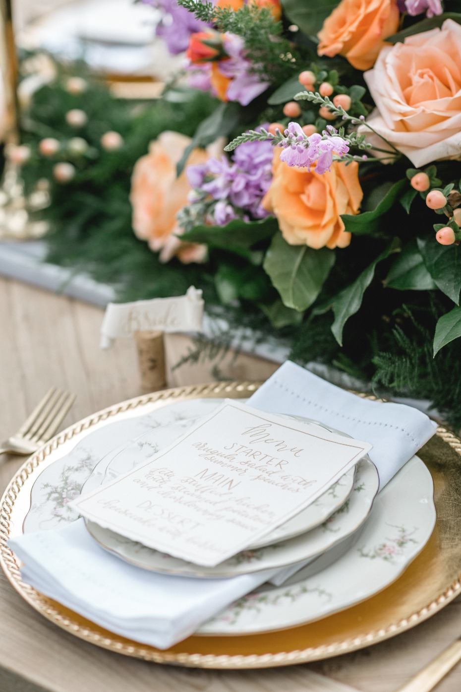 fantasy wedding place setting with gold and floral print china