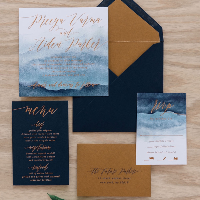 With copper foil elements and a cool, watercolor design, the Preeya invitation is perfect for a couple with unique style!