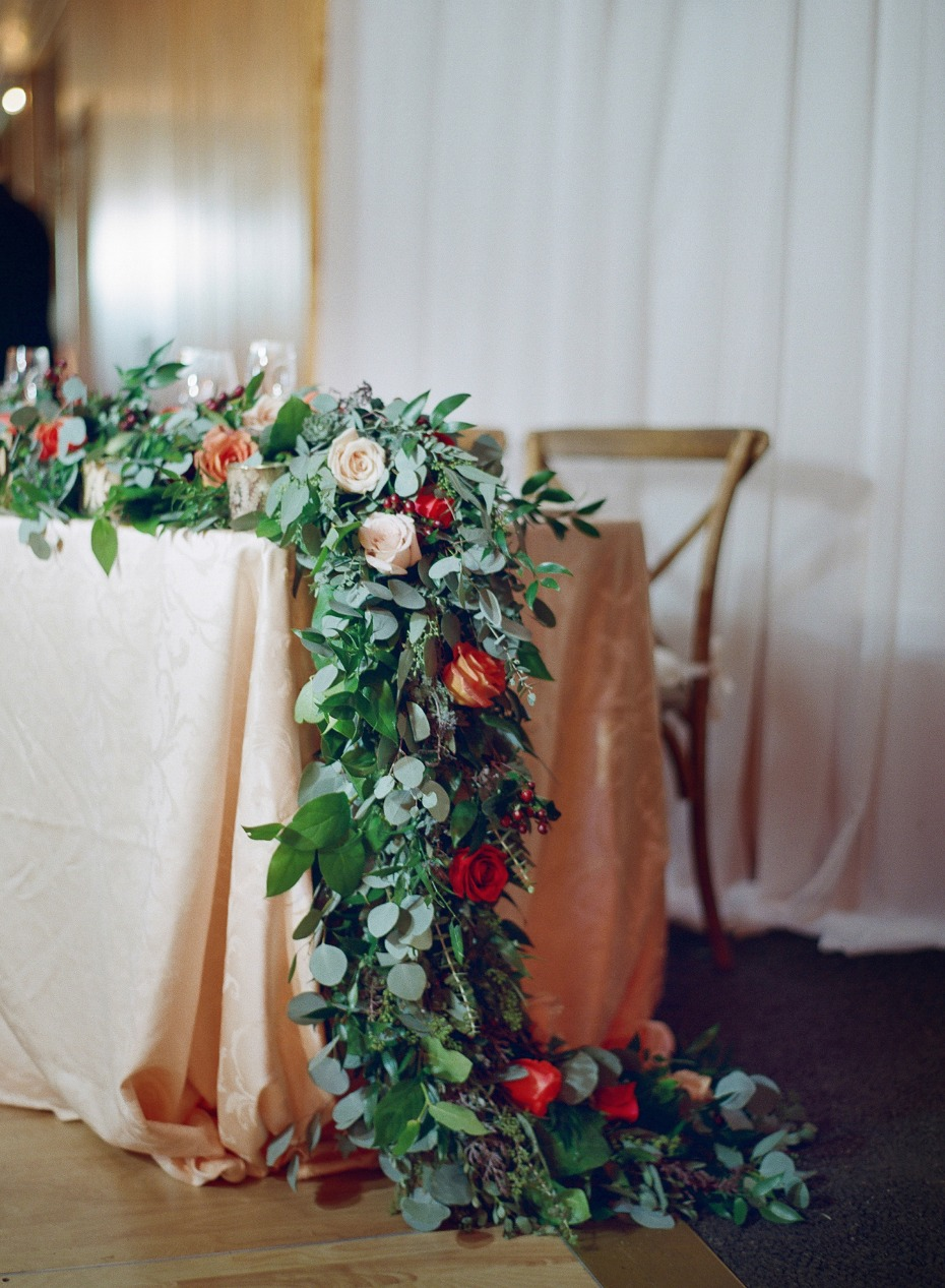 floral garland decorated sweetheart table