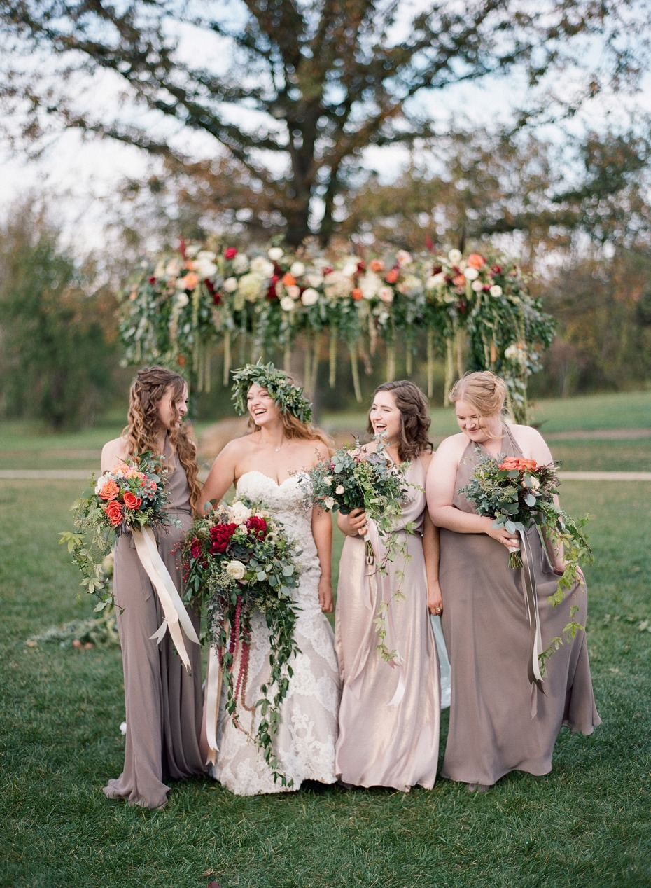 bride and bridesmaids in fall styled dresses
