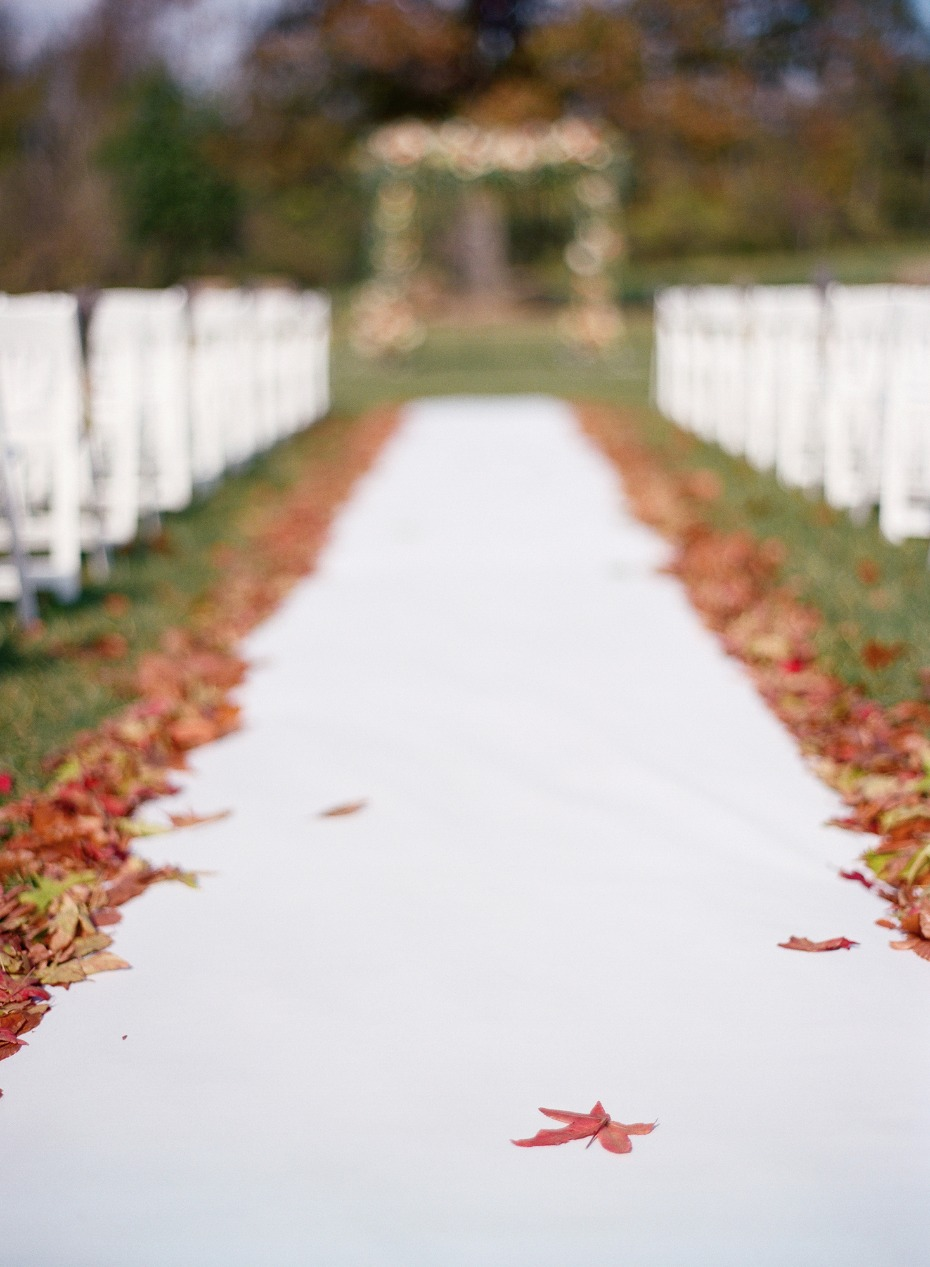 wedding aisle bordered with fallen leaves