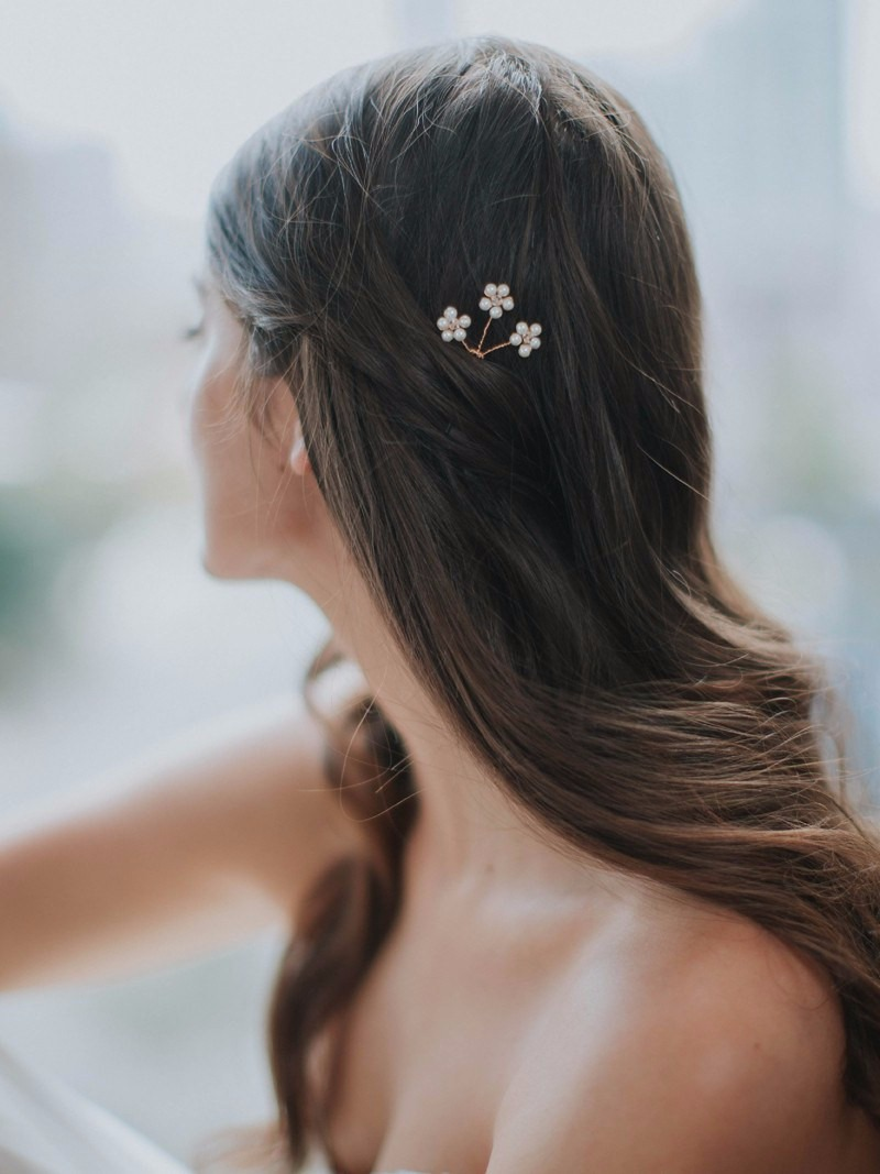 Daisy hairpins—worn in a chignon or in some beautiful, wavy mermaid hair.