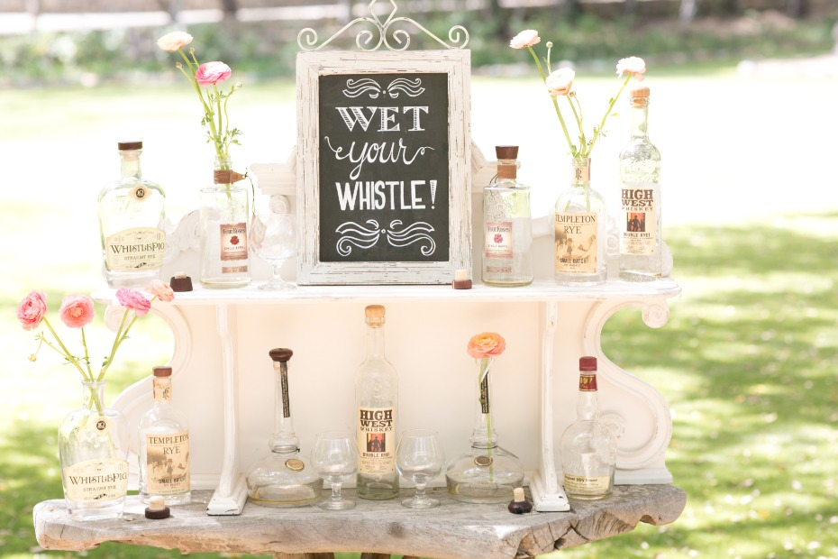 Use empty whiskey bottles as vases