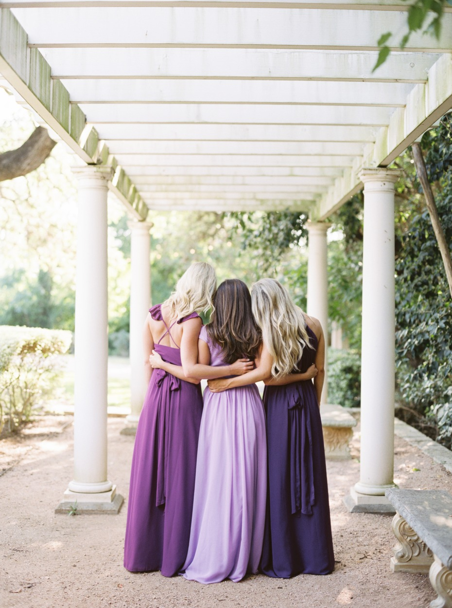 the back of the purple Revelry dresses