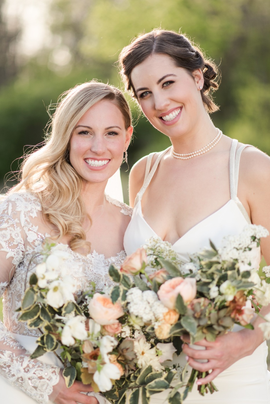 bride and her bridesmaid with peach and white bouquets