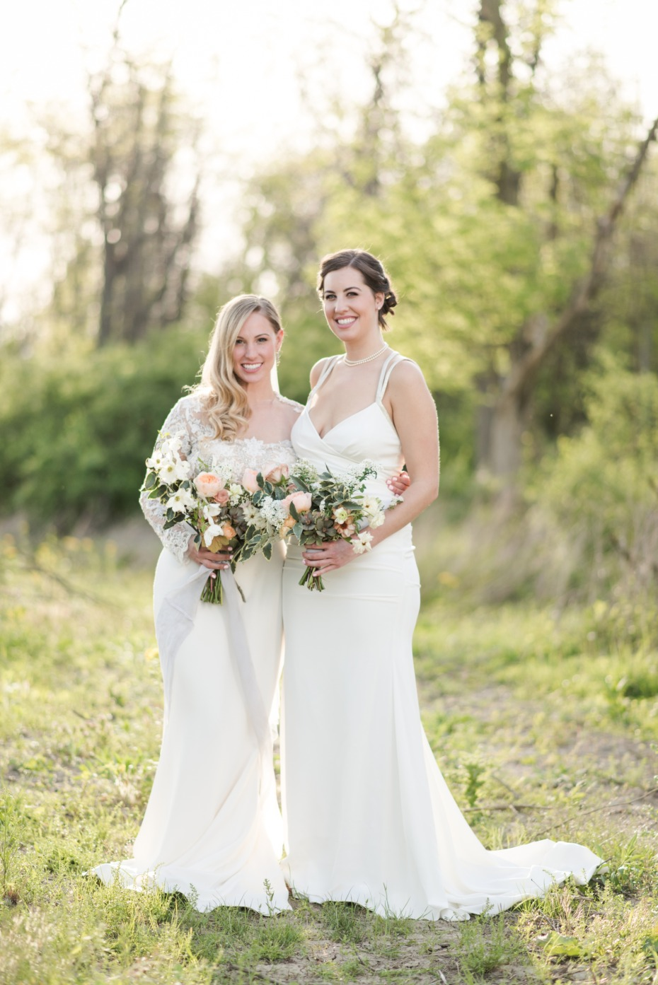 bride and bridesmaid in white