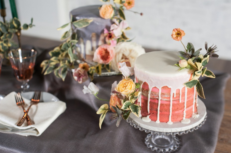 wedding cakes with drizzle frosting accented with flowers