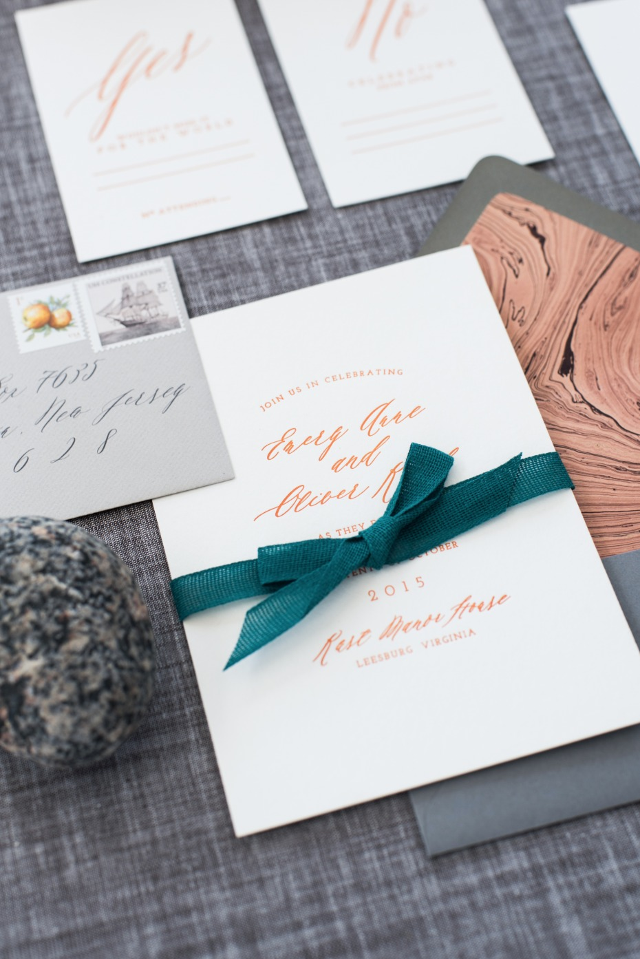 rose gold calligraphy wedding invites with emerald green ribbon