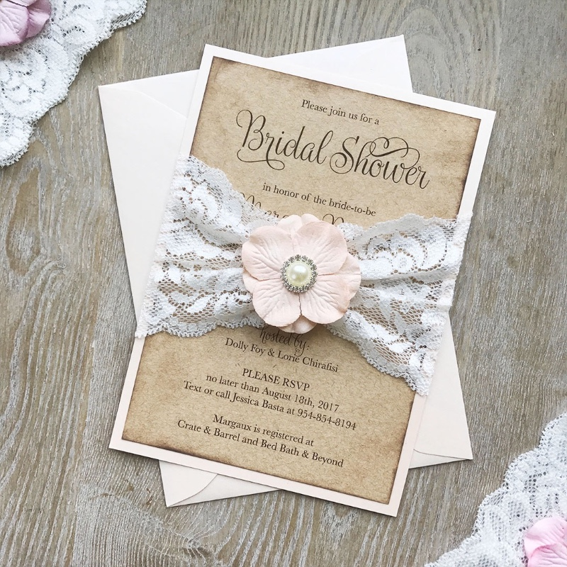 We love accessorizing invitations! Look how cute this Soft Peach Paper Flower & Pearl Button looks on our Boho Bridal Shower Invitation