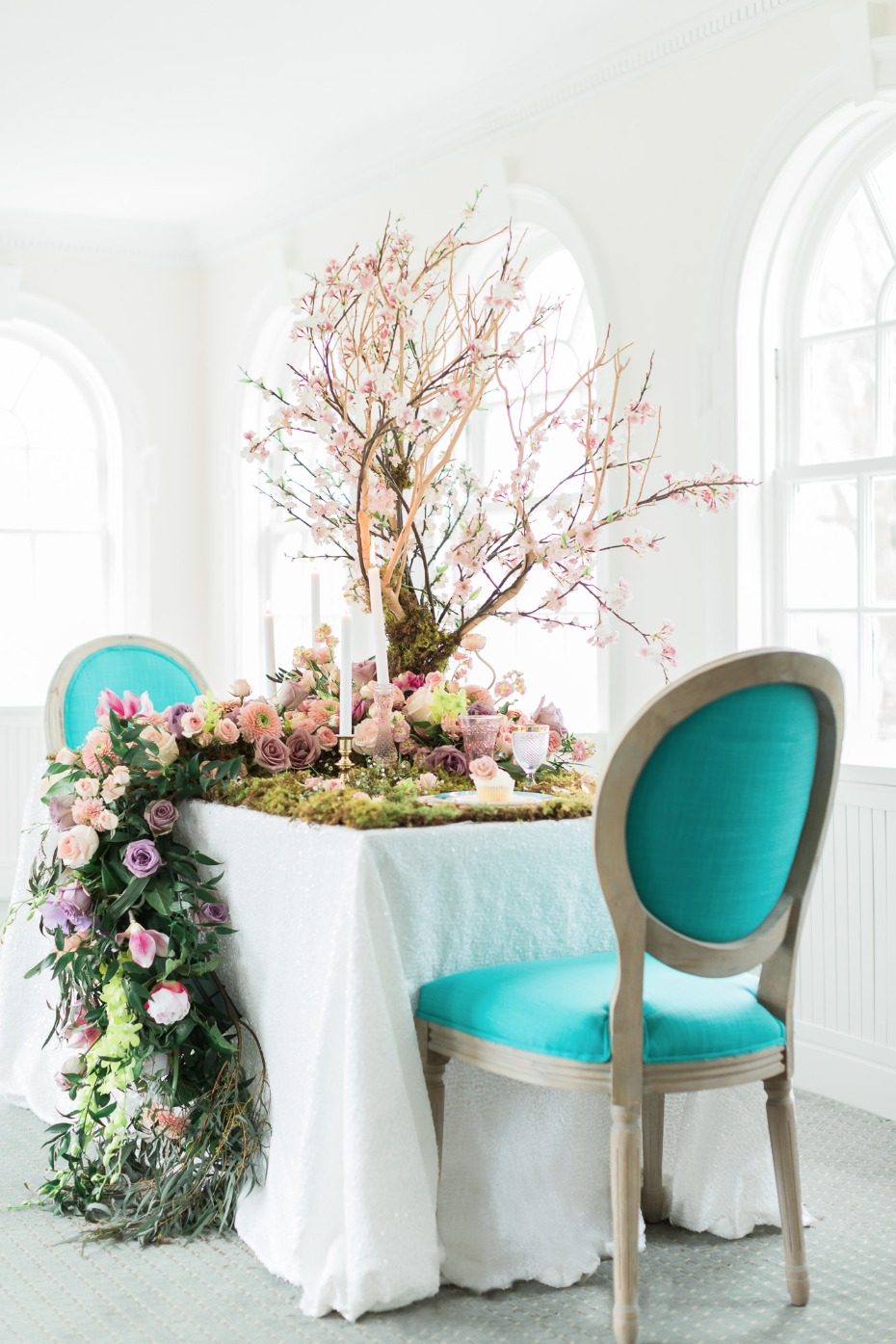 Teal chairs for this garden table setting