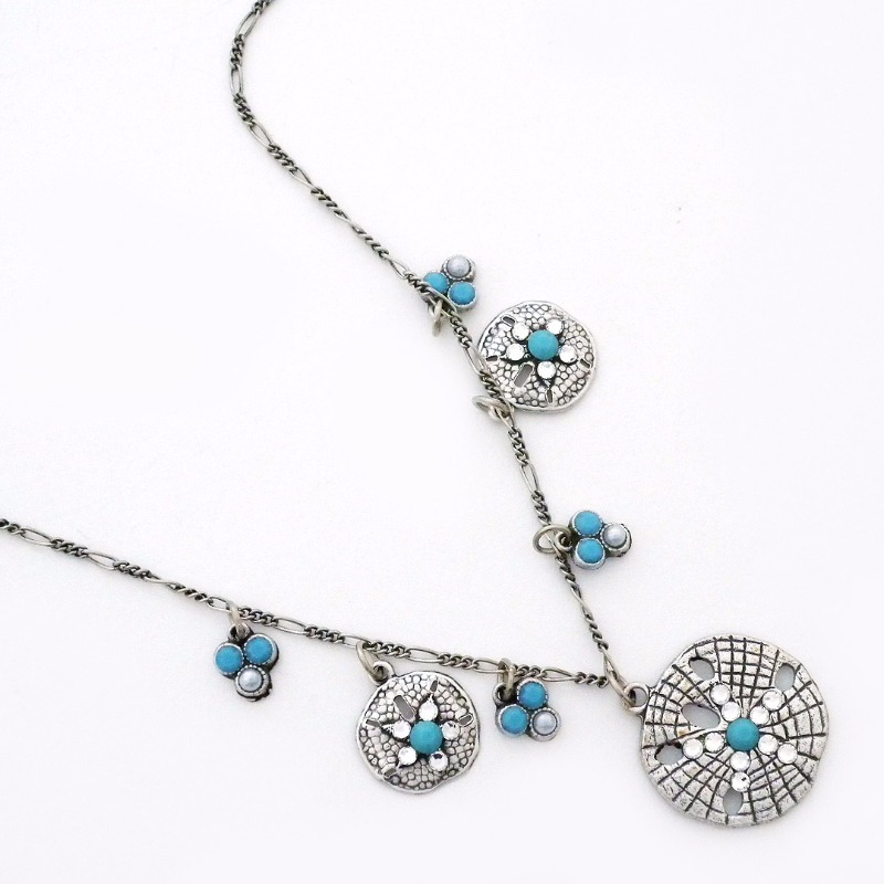 Sand Dollar necklace. Great bridesmaid gift for a destination or beach wedding. Even works for something blue.