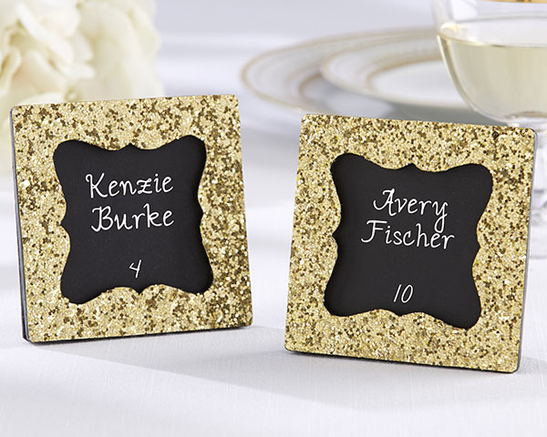 Use adorable gold glitter frames as place card holders at your reception, then guests take them home to use again as pretty picture