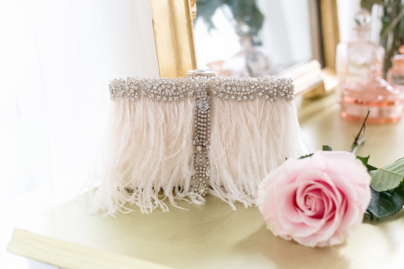 Ivory ostrich feathers and rhinestone are the perfect combination for this bridal purse.