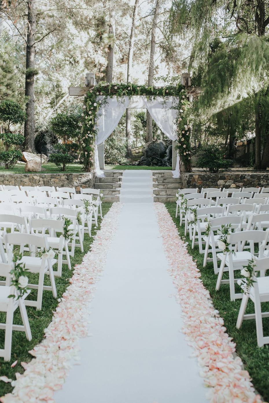 flower petal lined wedding aisle