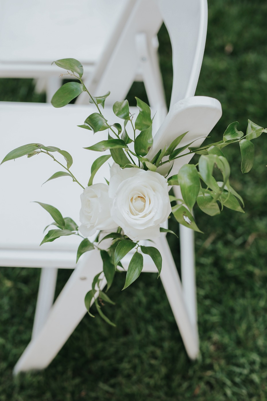 white roses and ivy wedding aisle decor