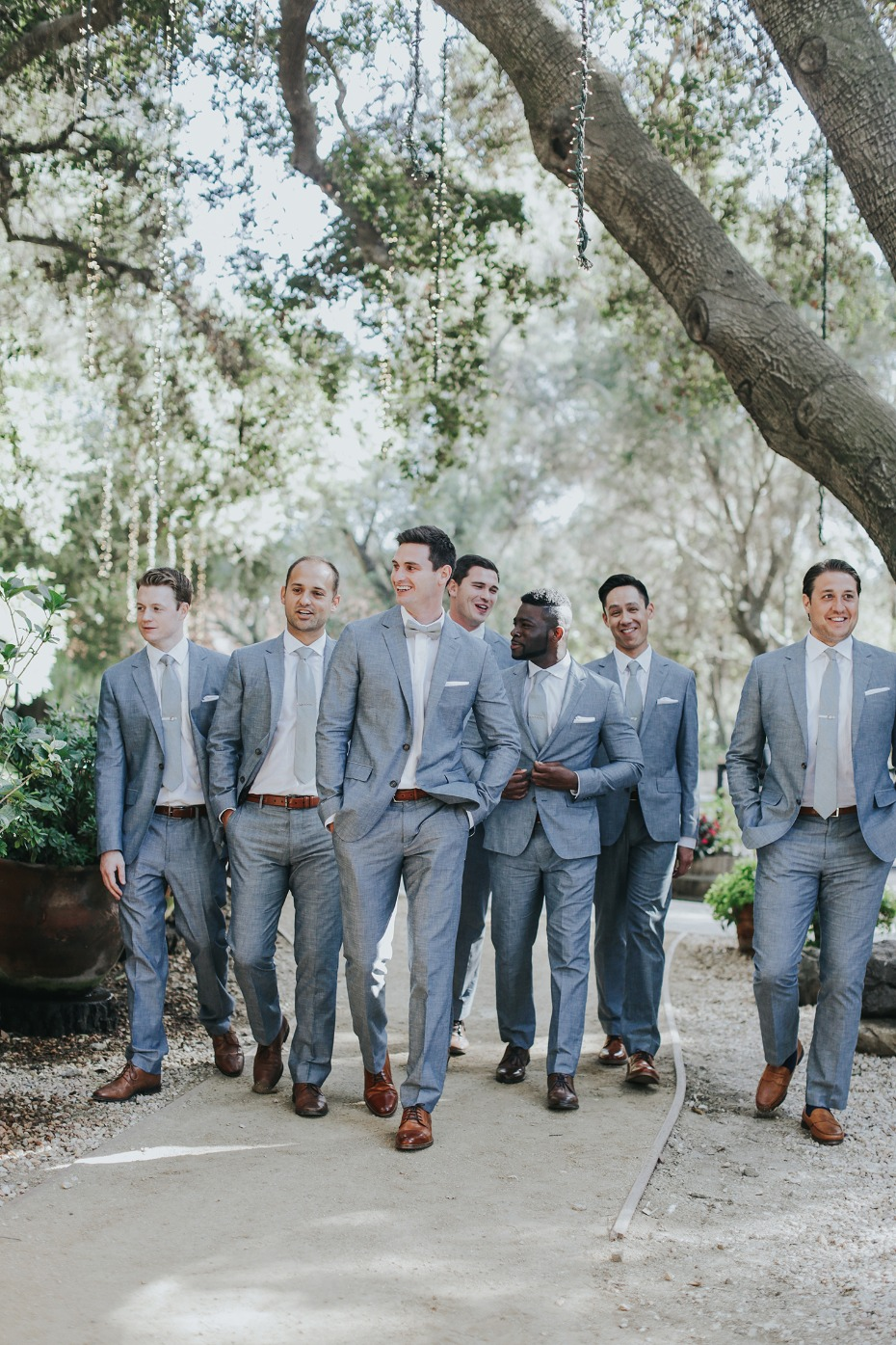 groom and his men in matching blue grey suits