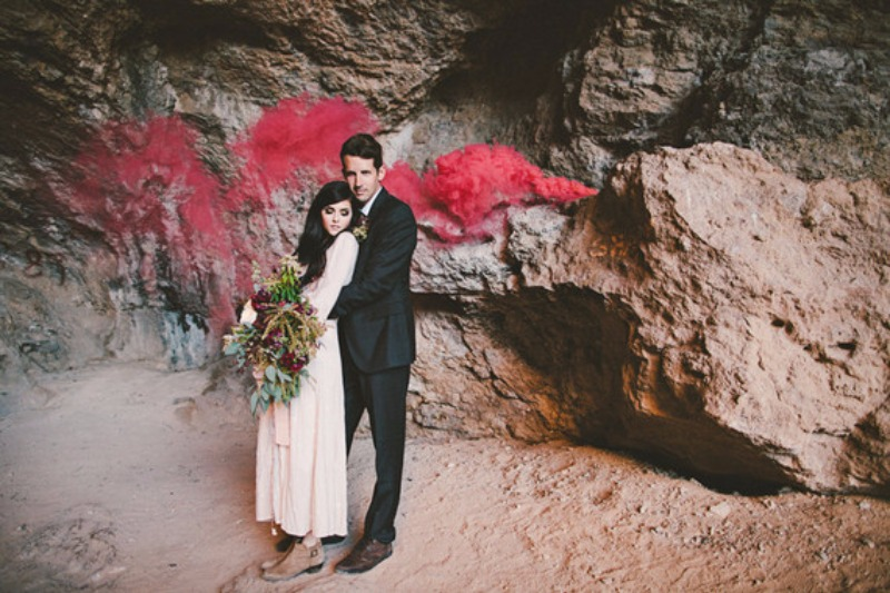 Messy bouquets, smoke bombs, and rural caves --- elopement perfection. Design: Bloom + Blueprint / Photo: Camitakesphotos
