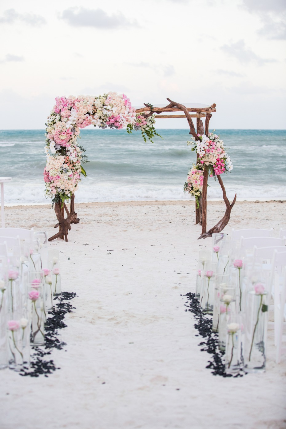 Dreamy beach wedding with drift wood chuppah