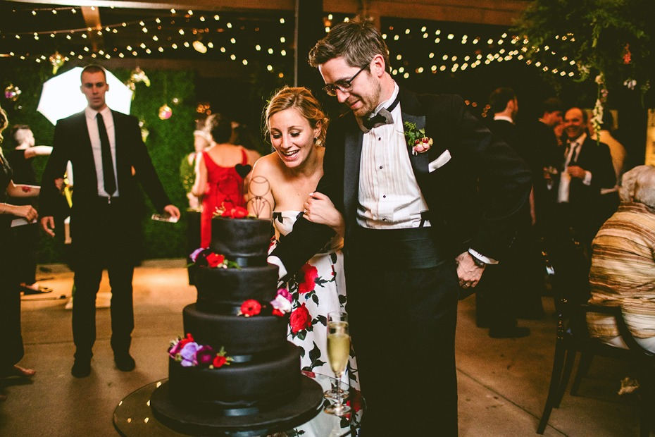 Black wedding cake with colorful flowers