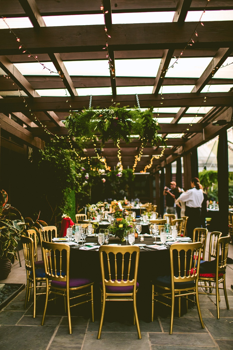 Gorgeous black and gold reception with jewel tones