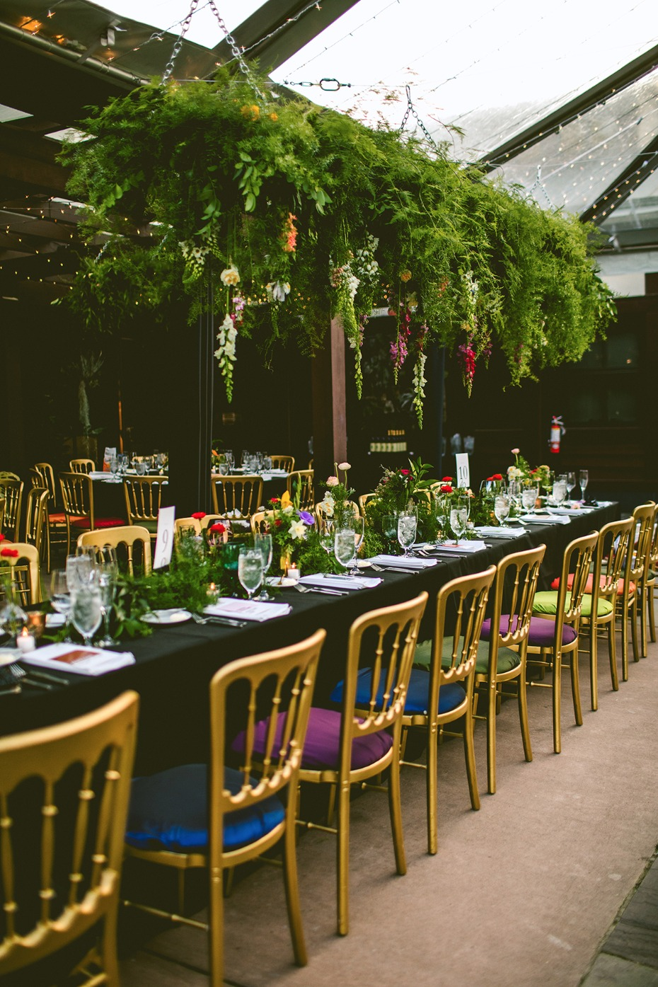 Greenery chandelier and Pantone colored gold chairs