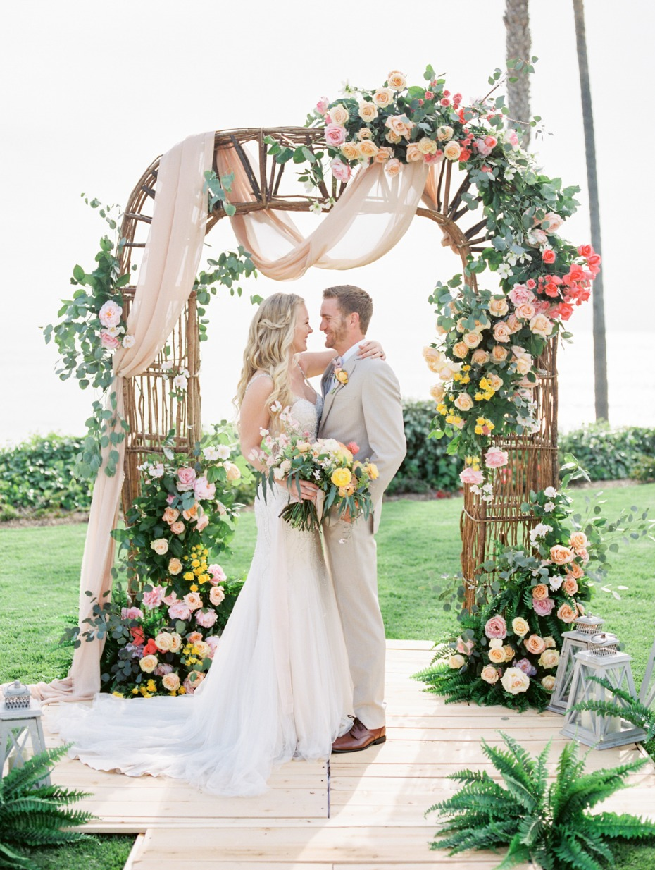 Colorful rose arbor with draping fabric