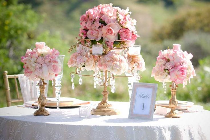Opulent Treasures chandelier entertaining pieces will help you create a stunning floral centerpiece for your wedding table.