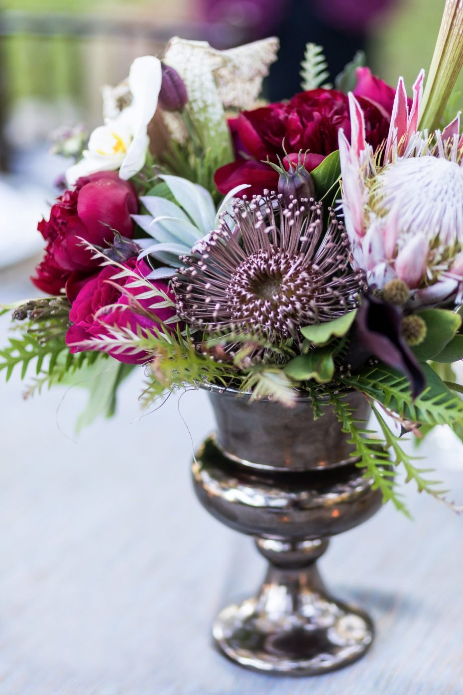 purple and magenta wedding centerpiece