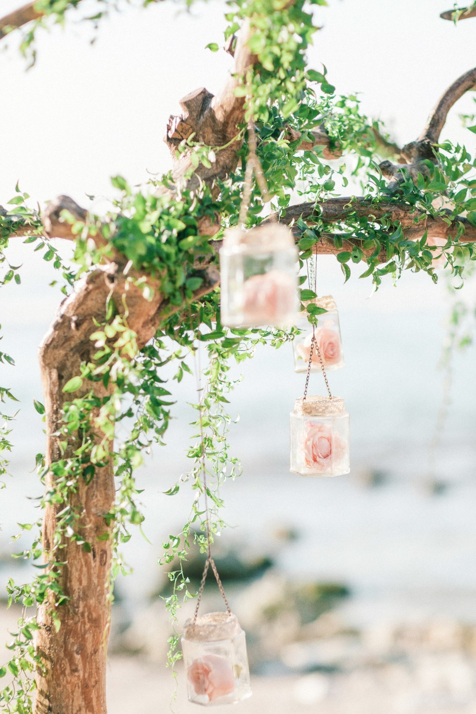rustic boho chic wedding arch with hanging roses