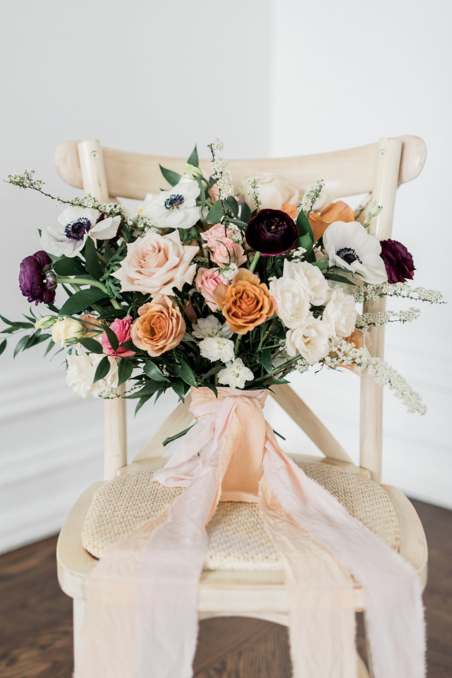 romantic peach and white wedding bouquet