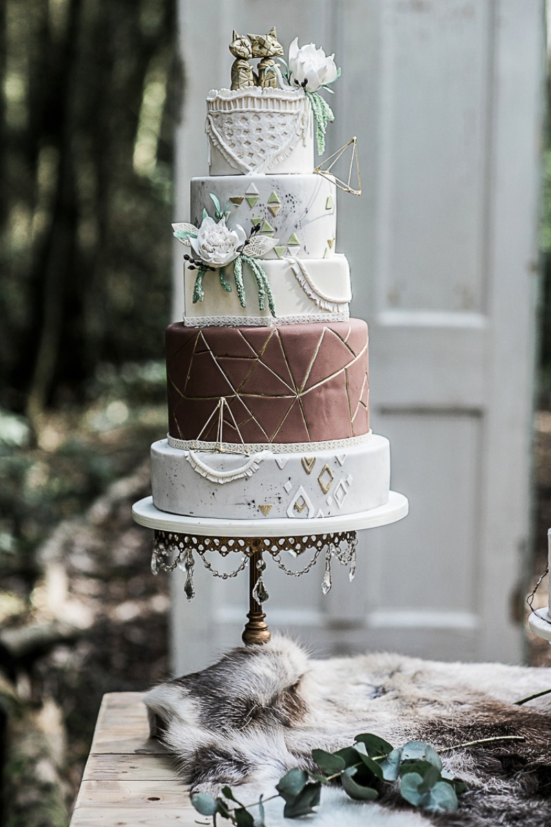 Bohemian Woodland Outdoor Wedding ~ Wedding Cake table ideas: Antique gold chandlier cake stand