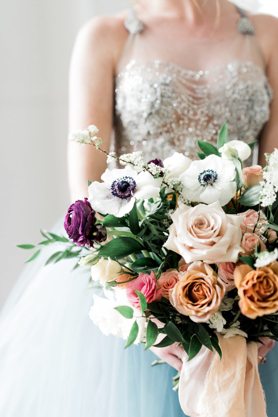 anomone wedding bouquet mixed in with roses