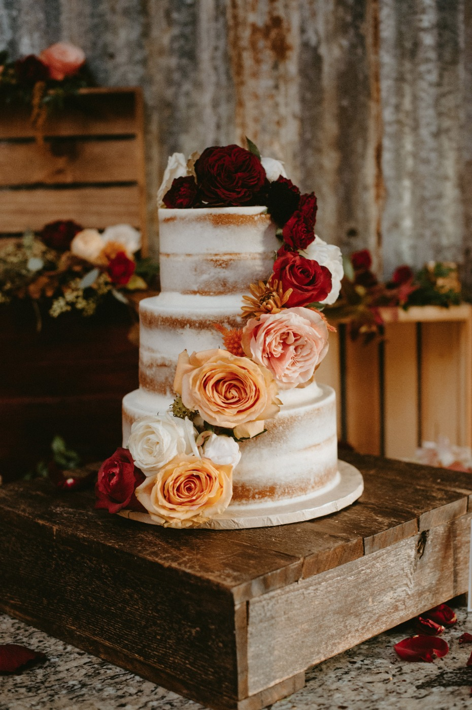 Naked wedding cake with fall florals