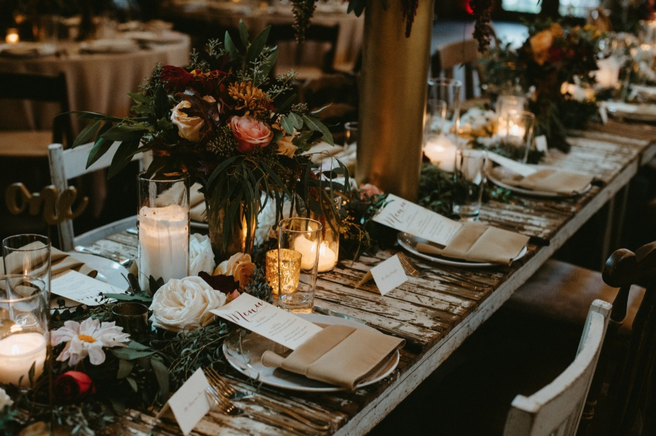 Rustic tablescape with candles and fall florals