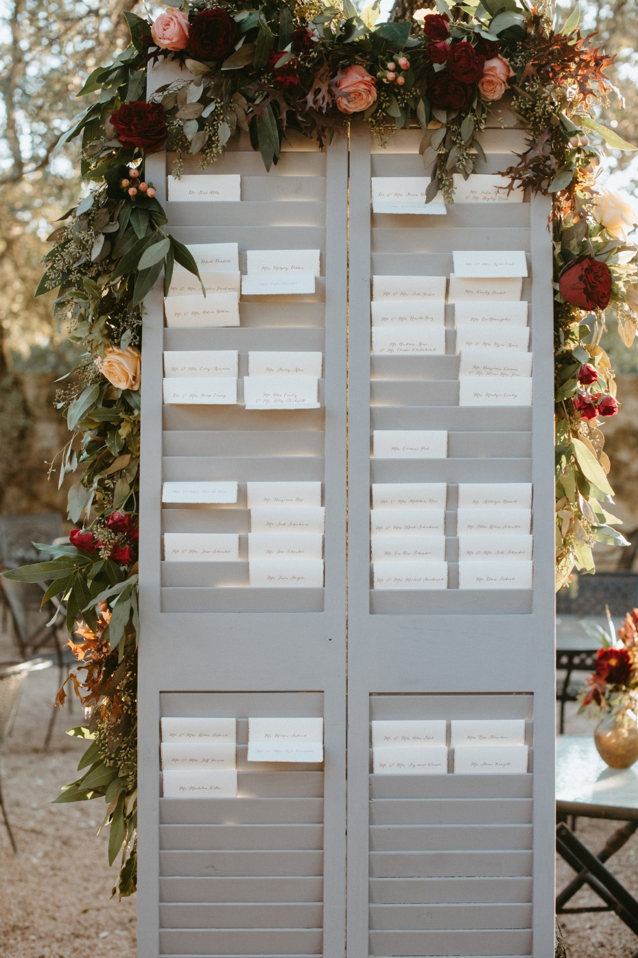 Shutter seating chart with fall floral garland