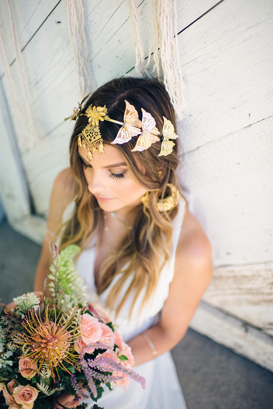 butterfly headpiece and tropical wedding bouquet