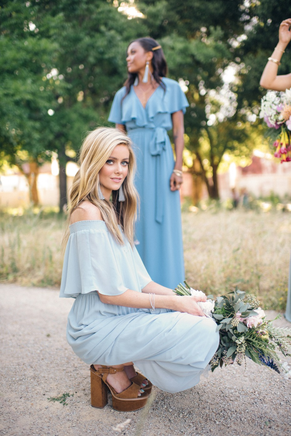 bridesmaid in chunky platforms and blue bridesmaid dress from Show Me Your Mumu