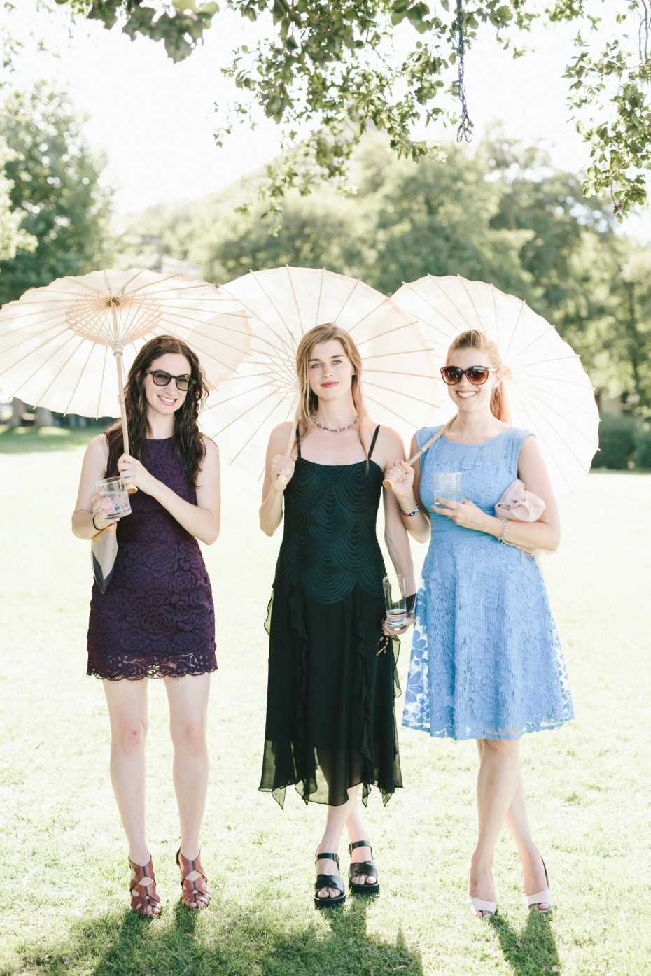 wedding guests with sun parasols