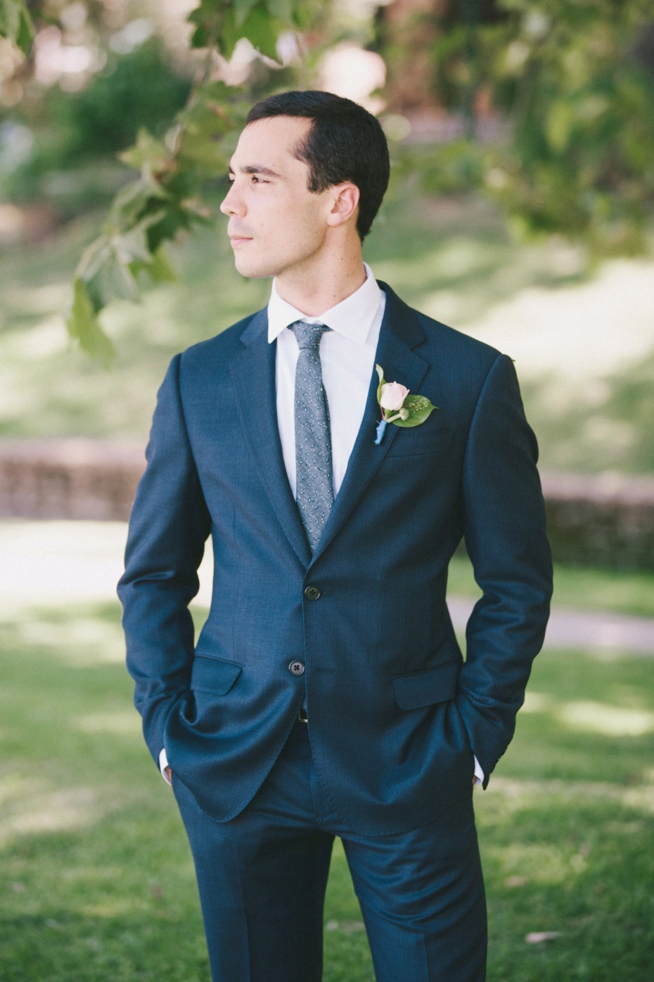 groom in classic navy wedding suit