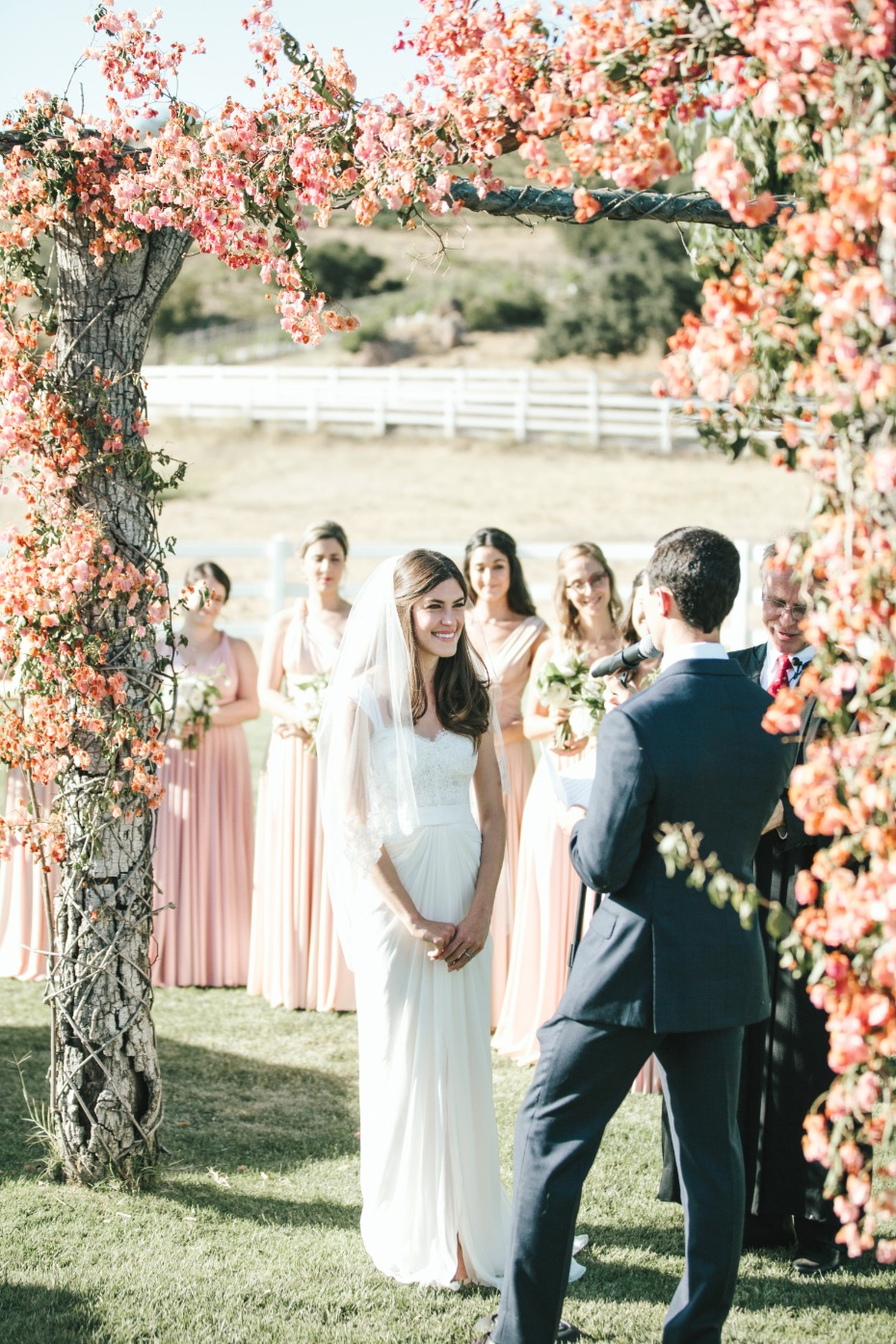 pink and peach floral wedding arch