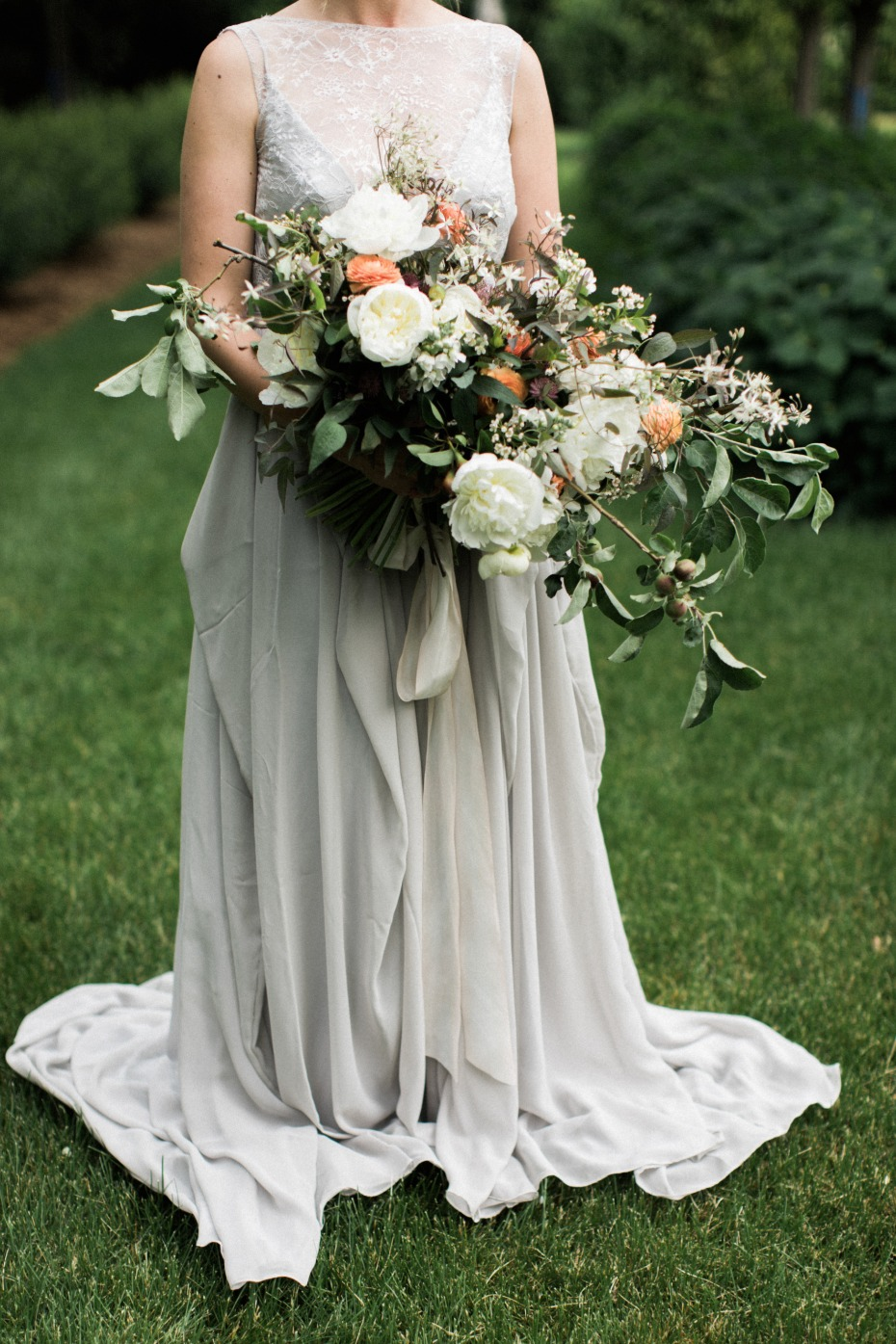 organic wedding bouuet paired with a dove grey wedding dress