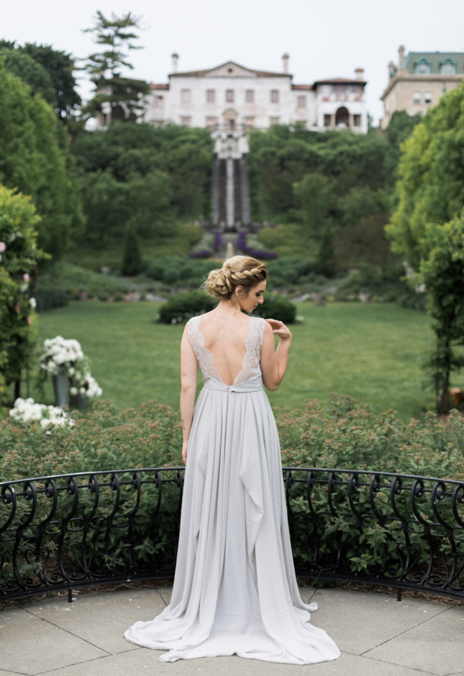 deep V back on this gorgous light grey wedding dress