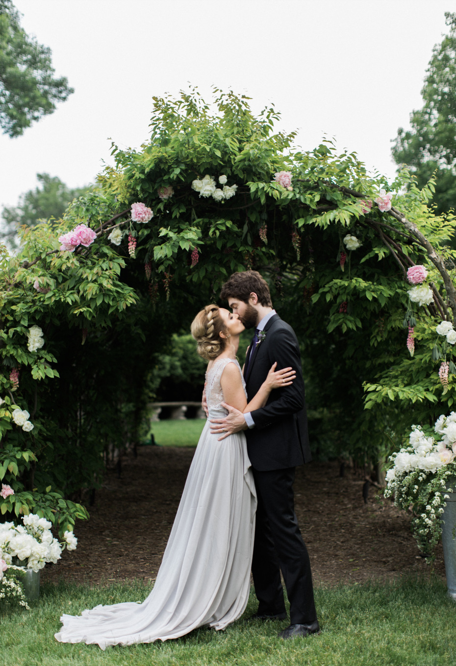 intimate outdoor ceremony at gorgous florals at  the Villa Terrace  an Italian Wedding Venue In States