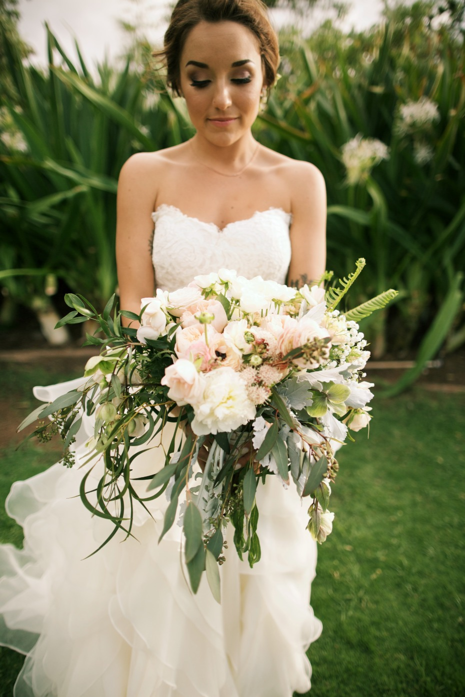 White and blush bouquet with loose greenery