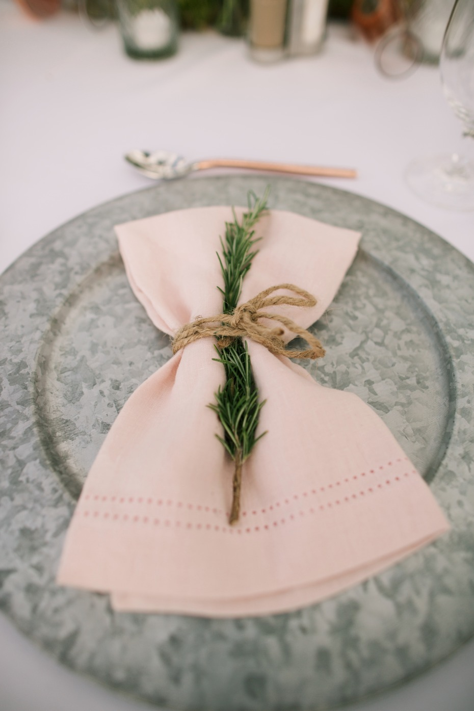 Simple place setting with a sprig of greenery