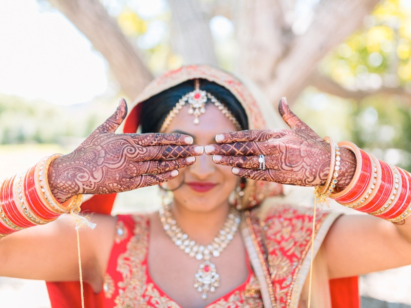 Henna, gold and a beautiful bride in elaborate, traditional Indian wedding dress at Greengate Ranch, San Luis Obispo.
