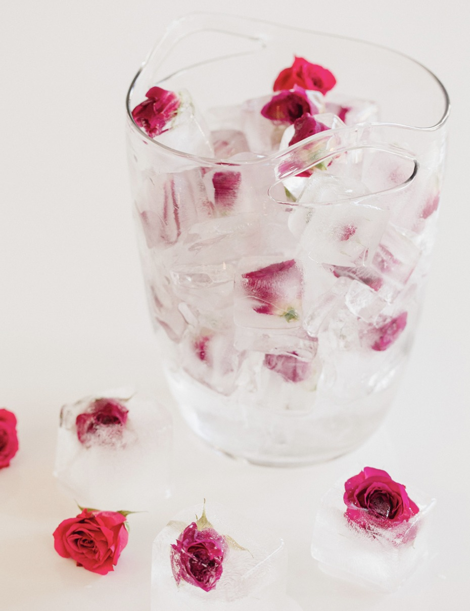 Glass ice bucket filled with dainty little roses
