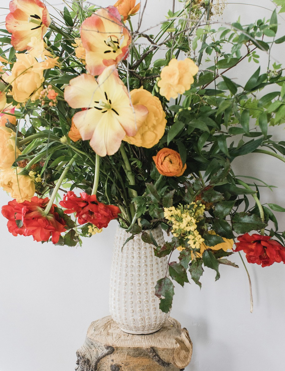 beautiful yellow, red and green floral arrangement