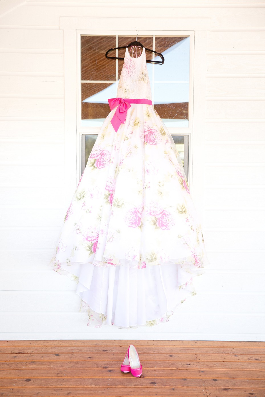 Floral wedding dress with a pink bow and shoes
