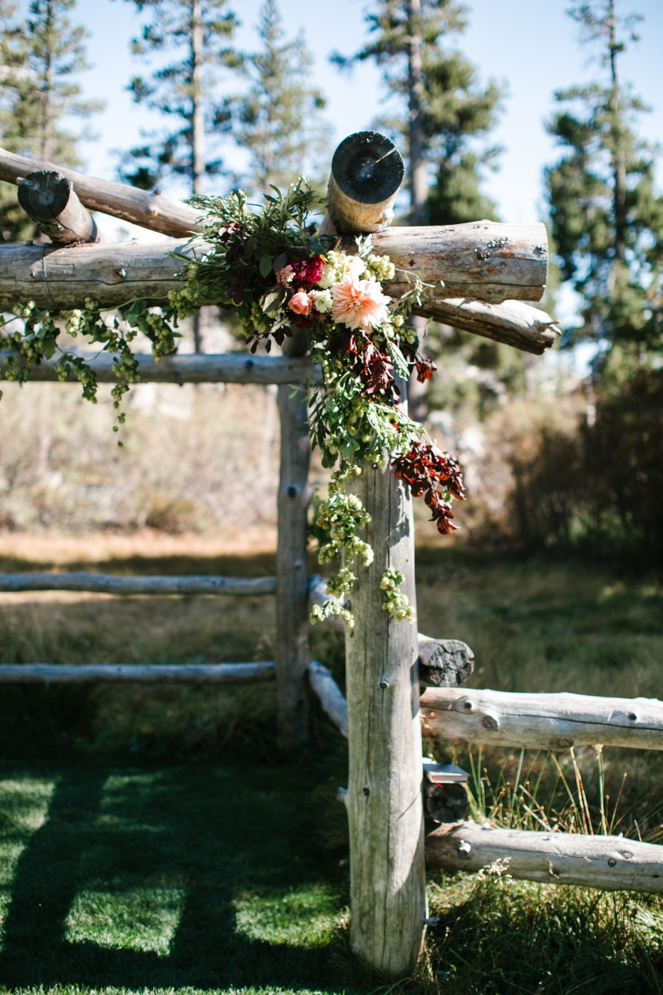 rustic flower accented wedding arch